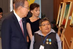 UNSG Ban Ki-moon viewing art of nuclear victim Karipbek Kuyukov at the UN commemoration
