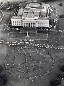 NUCLEAR PROTESTS The Auckland War Memorial Museum forms the backdrop for this aerial picture of the peace symbol on Saturday. 8 August 1983 New Zealand Herald Photograph by Ross Land kzm